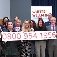 Winter Wellbeing team photo with telephone number